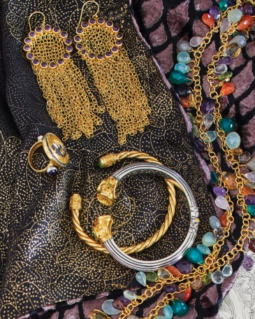 Pictured: assortment of J. Catma jewelry, including old-toned chandelier earrings, bracelet cuffs, rings, necklaces made from colorful beads