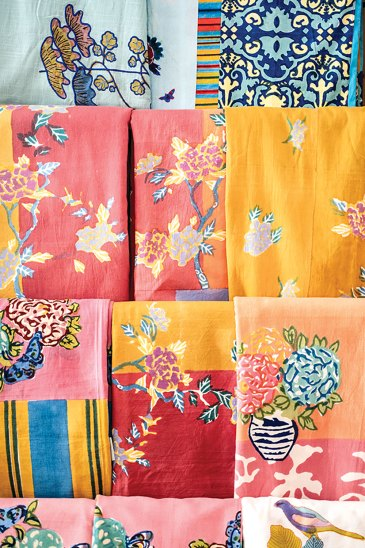 linens in an assortment of patterns, including florals, birds, and batiks