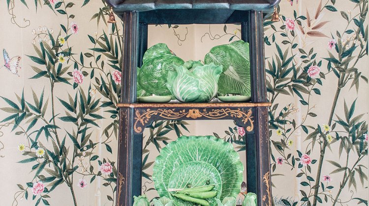 decorating with étagères, pagoda-shaped etagere, filled with green china, against chinoiserie wallpaper