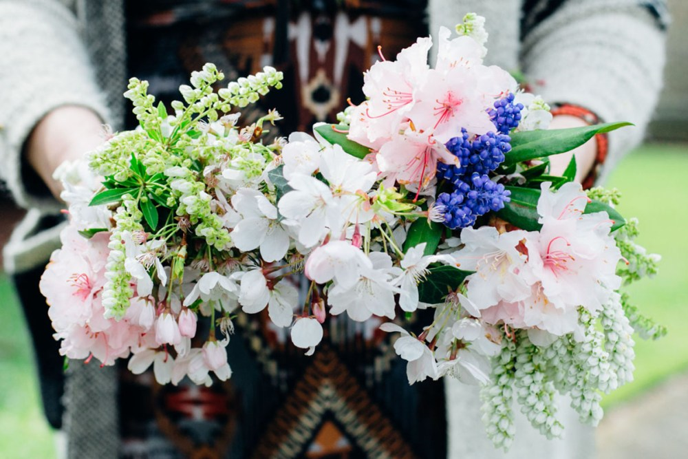 Natalie Ransom holds a bouquet of spring blooms collected from flower foraging