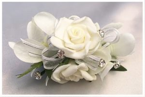 Orchid and roses mix with added diamantes.