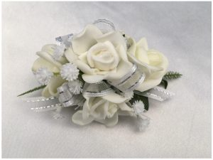 White roses, white with silver thread organza ribbon, baby's breath.