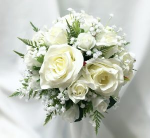 Natural bridal posy with a mix of white roses, baby's breath and greenery.