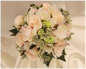 Flower girl posy with mini champagne roses, hydrangea and soft greenery.