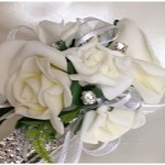 White roses with white organza ribbon and added diamantes