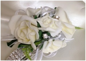 School balls white roses with white organza ribbon and added diamantes