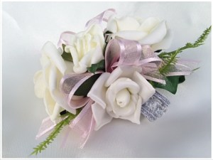 White roses,pale pink ribbon, silver wristband