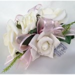 White roses,pale pink ribbon, silver wristband