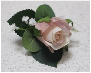 Pink/Mauve rose with gum and gyp buttonhole.