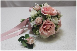 Bridesmaid posy with match groomsmen buttonhole. Dusty pink roses, gum and gyp.