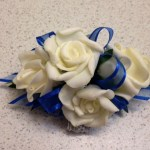 white roses with colbalt ribbon, silver wristband