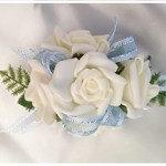 White roses, pale blue ribbon with silver thread.