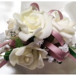 White roses, dusty pink satin ribbon, baby's breath, diamante sparkles.