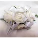 White roses, antique satin ribbon and diamantes' throughout.