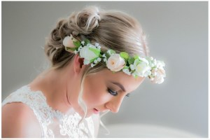Bride with cream and white rose hair circlet.