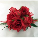 Bright red roses with red organza ribbon.