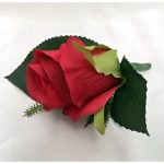 Bright red rose buttonhole.