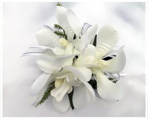Orchids with white organza ribbon and silver thread.