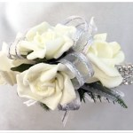 White roses, silver organza ribbon with silver thread, diamante wrist band.