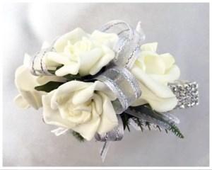 White roses, silver organza ribbon with silver thread, diamante wrist band.