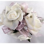 White roses, pale pink organza ribbon with added diamantes.