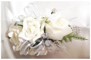 White roses, white organza ribbon with silver thread, diamantes and baby's breath.