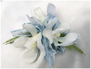 Orchids with pale blue organza ribbon, silver wristband.