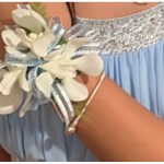 Orchids with pale blue ball gown and ribbon.