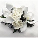 White roses and orchid mix, black organza ribbon, diamantes added.