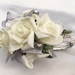 White roses, grey organza with silver thread ribbon, diamantes added, diamante wristband.