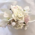 White roses and orchid mix, pale pink organza ribbon, baby's breath, diamantes added.