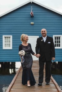 Happy couple at the Boat shed. Peony rose bouquet.