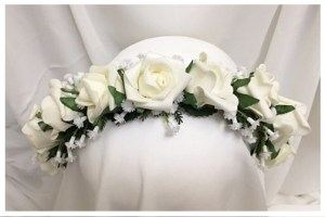 Flower girl headband with mini white roses, baby's breath, fine fern and rose leaves.