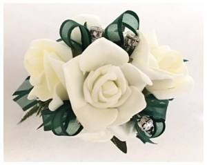 White rose wrist corsage with dark green organza ribbon, added diamantes.