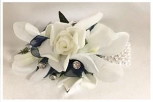 Rose and Orchid mix, navy organza ribbon, diamantes, pearl wristband.