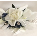 Rose and Orchid mix, navy organza ribbon, diamantes, pearl wristband.