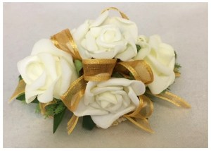 White rose wrist corsage with dark gold organza ribbon.