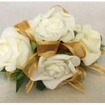 White rose wrist corsage with dark gold organza ribbon.