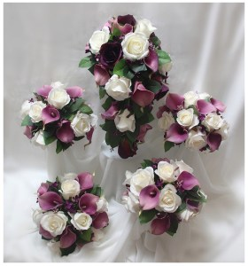 Bridal Party Bouquets, purple calla lilies, white roses, rose leaves natural posies and trailing bridal.