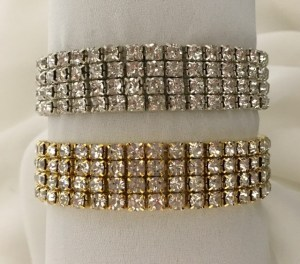 Silver or gold diamante elasticized wristbands.