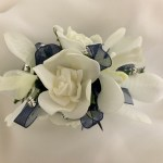 Orchid and rose mix with navy organza ribbon and diamantes added.