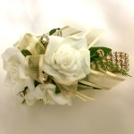 White roses, gold organza ribbon, gold diamante wristband and added gold diamantes.