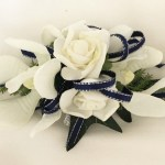 Orchid/rose mix with thin navy satin ribbon with silver thread.