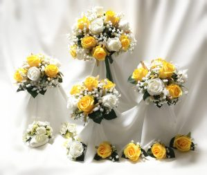 Yellow and white rose wedding party flowers.
