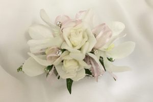 Orchid and rose mix with pale pink organza ribbon and added silver diamantes.