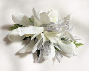 Orchid corsage with grey with silver thread ribbon.