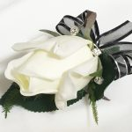 White rose buttonhole with diamante`s, black organza ribbon with silver thread.