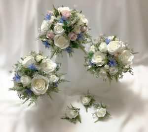 Cottage garden natural posy. Using mixed white roses, micro pink and blue flowers, queen anne lace, baby's breath.
