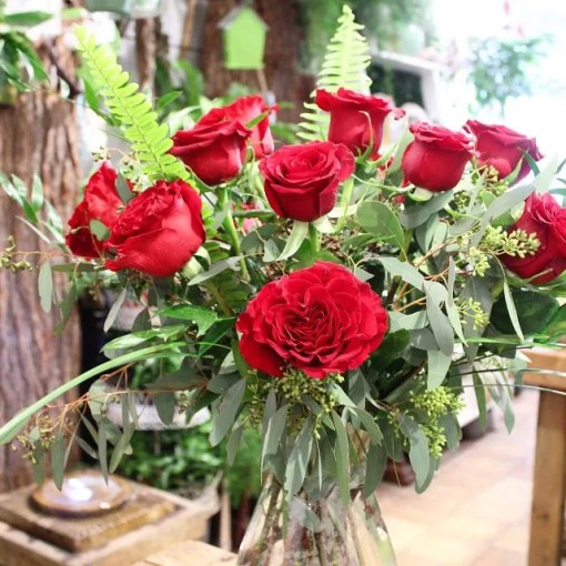 dozen red roses in a vase