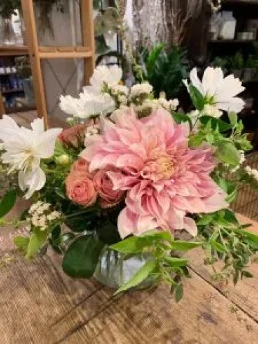 Cafe au last dahlias with pink spray roses, white cosmos, white statice and mint.